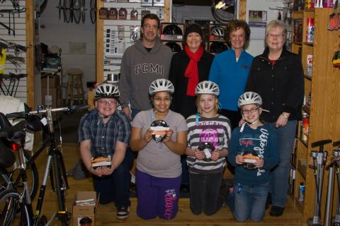 Kinship, Itascatur and Northern Cycle give helemts to kids.